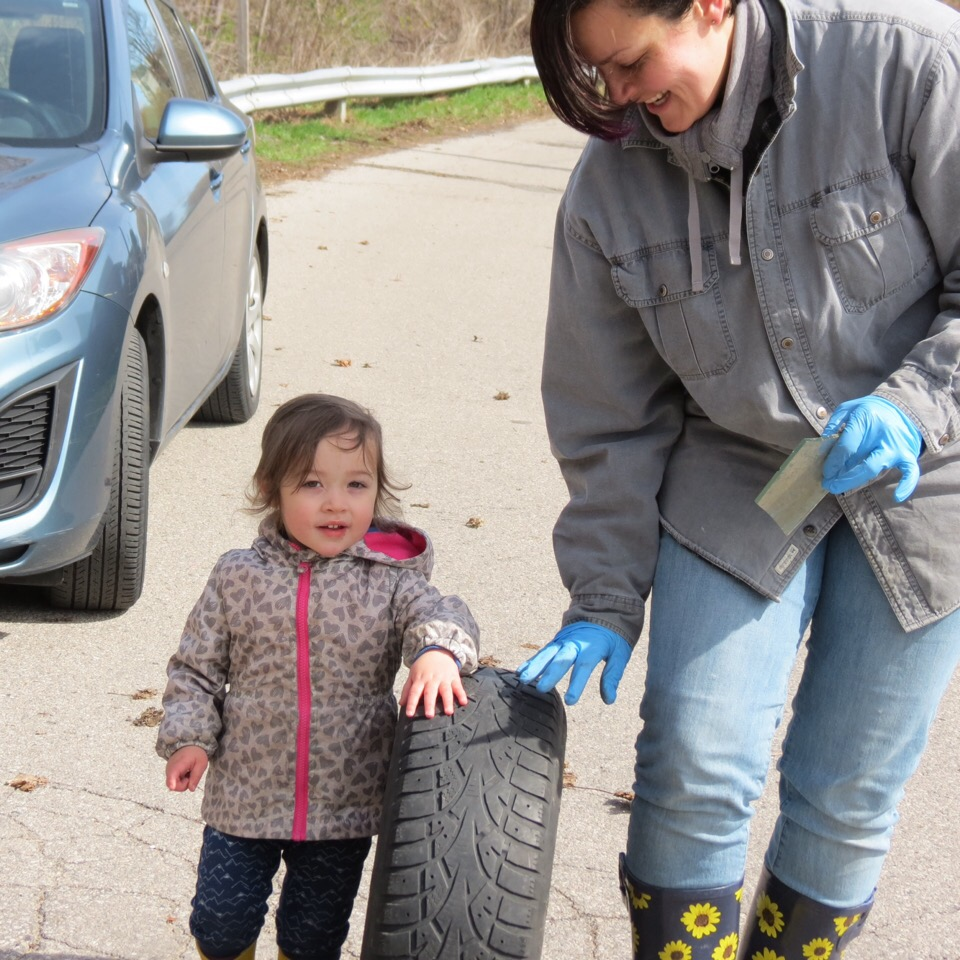 Girl rolling a car tire